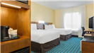 Queen guest room with two beds and complimentary accommodations
