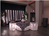Black and white wedding reception lighted cake table