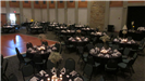 Elegant black and white wedding reception of pre set tables with black table cloths accented with wh