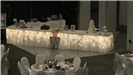 Lighted wedding cake station with two tables