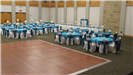 Turquoise and white wedding reception with table settings of turquoise table cloths with a dance flo