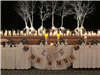 Winter white wedding reception head table with love and mr and mrs signs with white tree branches in